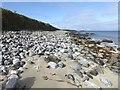 NB2547 : Stony beach on the west side of Loch Shiaboist by Oliver Dixon