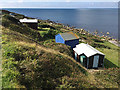 SY6873 : Huts along the West Weares, near Chiswell, Portland by Robin Stott
