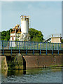 SK5704 : Soar weir walkway and cement plant in Leicester by Roger  Kidd