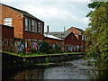 SK5705 : Industry by the Grand Union Canal in Leicester by Roger  Kidd