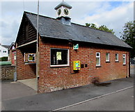 SU1660 : Yellow defibrillator box and a public clock, Market Place, Pewsey by Jaggery