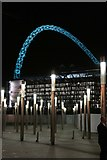 TQ1985 : Wembley Stadium lit up in sky blue by Steve Daniels