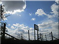 TL0629 : Gate and fence in silhouette on the Moleskin and Markham Hills by Peter S
