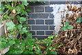 TL1896 : Benchmark on Celta Road railway bridge wall by Roger Templeman
