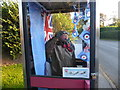 SK8686 : A close up of the airman in the telephone box at Upton by Marathon