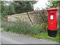 TL5150 : Pillar box, flowers and wall, High Street, Babraham by Humphrey Bolton