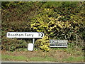 TM4198 : Roadsign & Low Road sign on Loddon Road by Geographer