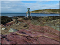 SH3793 : Tide and Time Bell and colourful rocks, Cemaes by Robin Drayton