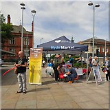 SJ9494 : Charity stall on Hyde Market by Gerald England