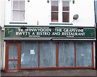 SH5638 : The Grapevine Restaurant in Porthmadog closes by Arthur C Harris