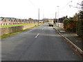 NJ5529 : Road (B9002) passing the Ardmore Distillery by Peter Wood