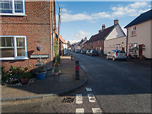 TM0890 : The main street of New Buckenham by Neville Goodman