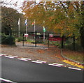 SO3801 : Four flags and flagpoles in the grounds of an Usk school by Jaggery