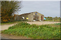 TG2229 : Derelict farm buildings near Pond Farm by Ian S
