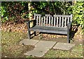 TG3109 : WW2 commemorative bench in Brundall cemetery by Evelyn Simak