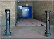 TG5307 : Cast-iron bollards at the rear of the Marina Centre by Evelyn Simak