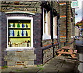 SS9389 : Window display of old bottles and jugs in Ogmore Vale by Jaggery