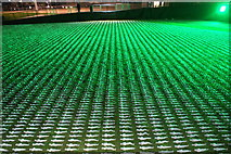TQ3783 : View of Shrouds of the Somme figures illuminated by green lights from the perimeter path around the South Lawn by Robert Lamb