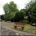 ST2281 : Wooden benches in a small burial ground, Old St Mellons by Jaggery