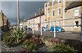 NZ0737 : Sunlit houses beyond sturdy railings by Trevor Littlewood