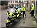 TF4609 : Police motorcycle outriders killing time in The Crescent, Wisbech by Richard Humphrey