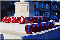 SP3509 : Close view of wreaths around War Memorial, Church Green, Witney, Oxon by P L Chadwick