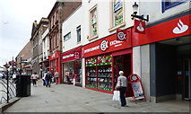 NS3321 : A row of red fronted shops on Ayr High Street by Thomas Nugent