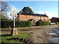 TM4899 : Ashby Hall Farmhouse & Ashby Village sign by Adrian Cable