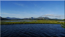 SH5838 : View across marshes towards Snowdon, Cnicht & the Moelwyns from The Cob, Porthmadog by Colin Park