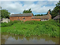 SK0121 : Old barns at Colwich in Staffordshire by Roger  Kidd