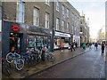 TL4458 : Shops on Sidney Street by Hugh Venables