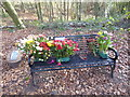 TQ4677 : Memorial bench in Bostaall Woods by Marathon