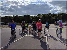 ST5294 : Cyclists resting at the entrance to Chepstow racecourse car park by Rob Purvis