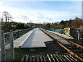 NZ8809 : Ruswarp railway bridge, along the track by Stephen Craven