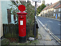 NZ8809 : Post box outside the old post office, Ruswarp  by Stephen Craven