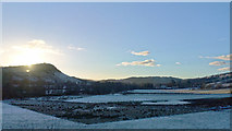 NH5159 : Sun setting over Knockfarril from above Fodderty by Julian Paren