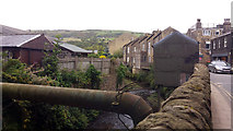 SE0125 : Pipe and cabins over the Cragg Brook, New Road, Mytholmroyd by Phil Champion
