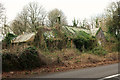 SX8954 : Overgrown listed building, Kennel Wood by Derek Harper