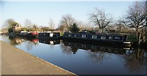 TQ1479 : View of narrowboats and a house reflected in the Grand Union Canal near Three Bridges by Robert Lamb