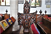 TL8866 : Great Barton: Holy Innocents Church: Finely carved poppyhead 6 by Michael Garlick