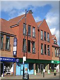 TQ1649 : Shops on High Street by Oast House Archive