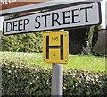 SO9623 : Yellow hydrant marker, Deep Street, Prestbury by Jaggery