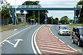 SX9885 : A376 Footbridge at Exton by David Dixon