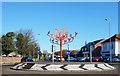 TA2047 : Orange Birds on the Roundabout by Des Blenkinsopp
