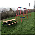 SN9926 : Picnic bench and children's play area in Libanus, Powys by Jaggery