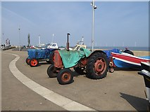 NZ6025 : Tractors and fishing boats on Redcar seafront by Oliver Dixon