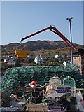 NR8668 : Lobster creels on Tarbert Quay by Alec MacKinnon
