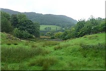 NY3404 : Loughrigg Tarn from under Neaum Crag by DS Pugh