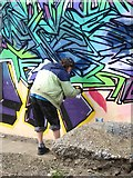 NT2676 : Graffiti artist at work by Oliver Dixon