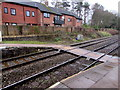 SJ3165 : Level crossing at the southern end of Hawarden railway station, Flintshire by Jaggery
